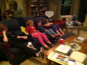 Cousins all watching a movie