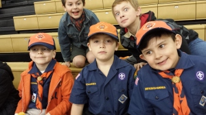 Tiger Cubs watching the game (Greg is so not amused that his daddy is blocking his view path).