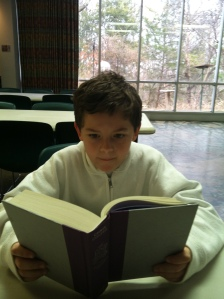 This is so obviously my kid. We sat across from each other and read. People thought it was weird. ;)