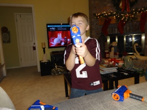 Greg loves his new take-apart nerf gun from Aunt April
