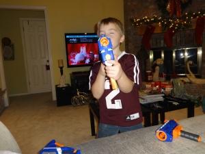 Greg loves his new take-apart nerf gun from Aunt April