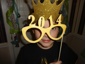 We loved glittering up these photo booth props. (We found them online and cut them out ourselves.)