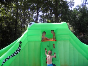 One day a friend called and asked us over right that minute to help try out an inflatable water slide they got for a party. Of course we went right over!